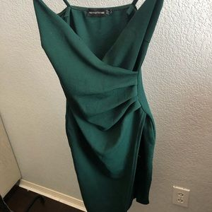 An olive green tight slit dress